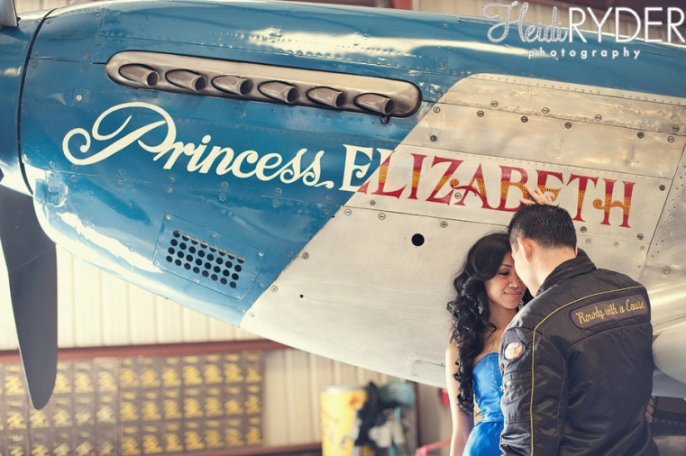 Couple in front of vintage Princess Elizabeth airplane