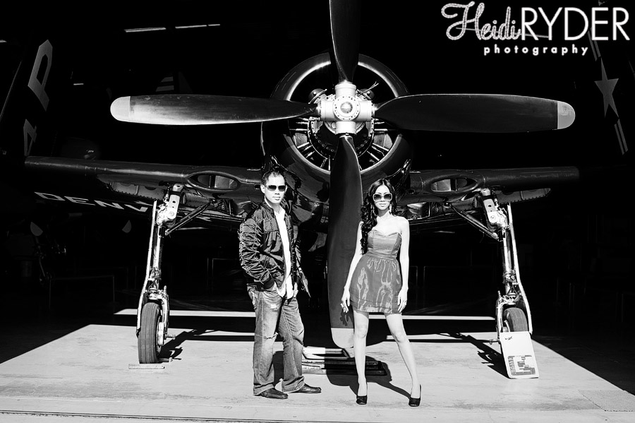 Couple in front of large airplane