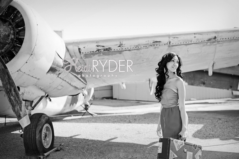 Woman posing with vintage airplane