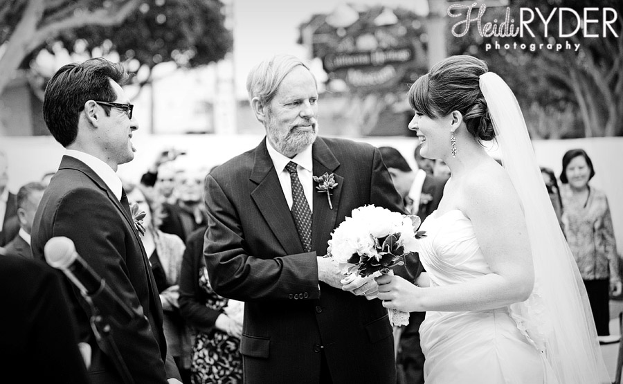 bride being handed of to groom by dad in wedding ceremony