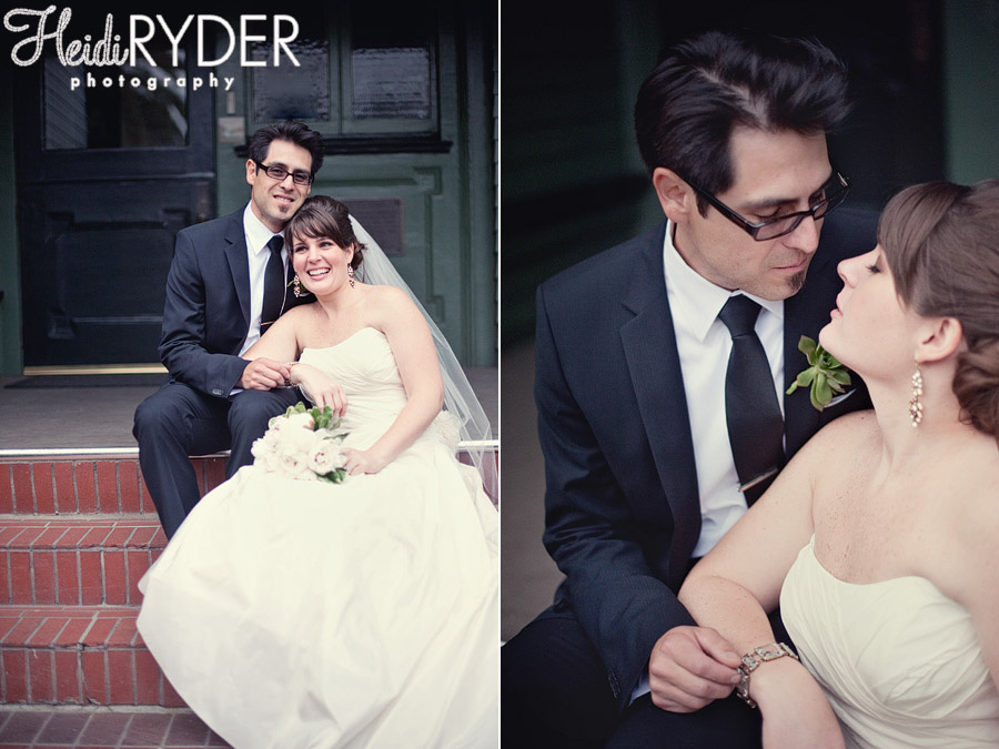 bride and groom sitting on steps of historic house