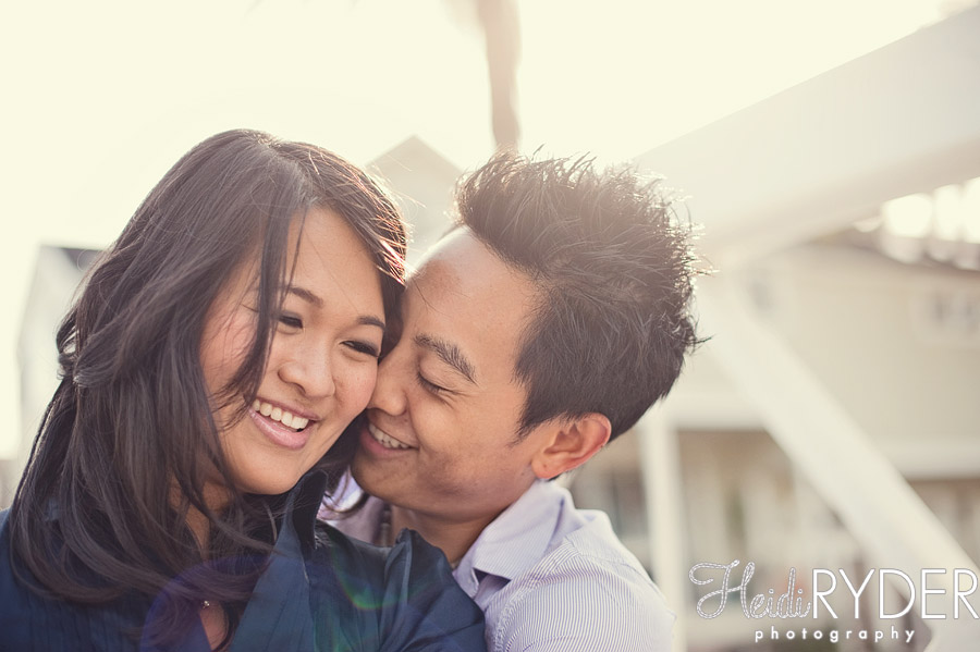 couple smiling, warm sunlight venice canals engagement