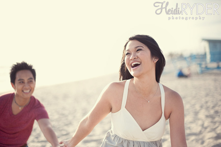 Couple laughing and playing on beach in Venice, CA