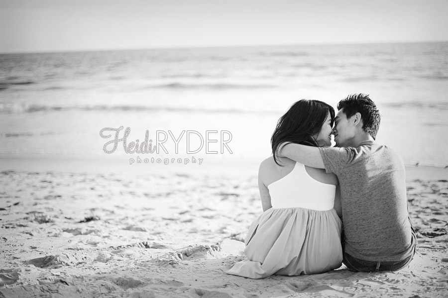 Couple sitting on beach in love