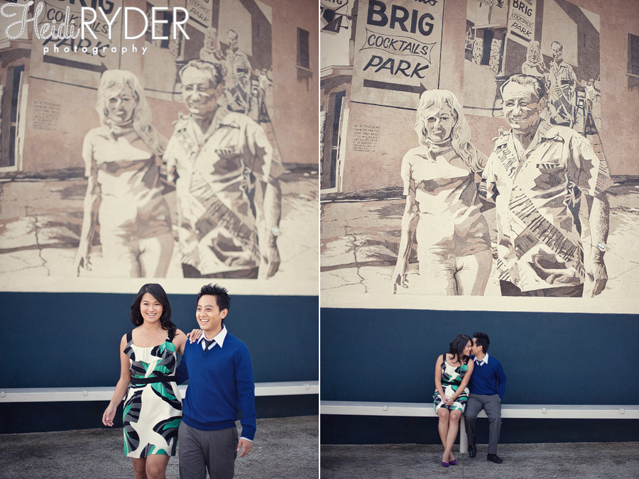 Couple posing in front of The Brig mural, Venice