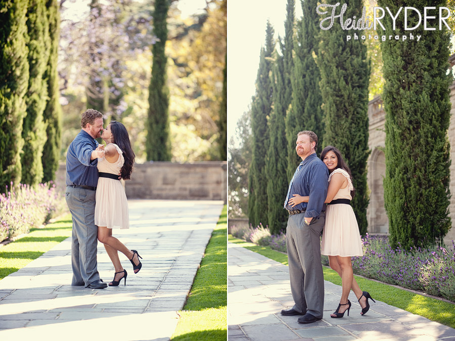 Couple flanked by cypress trees at Greystone Mansion