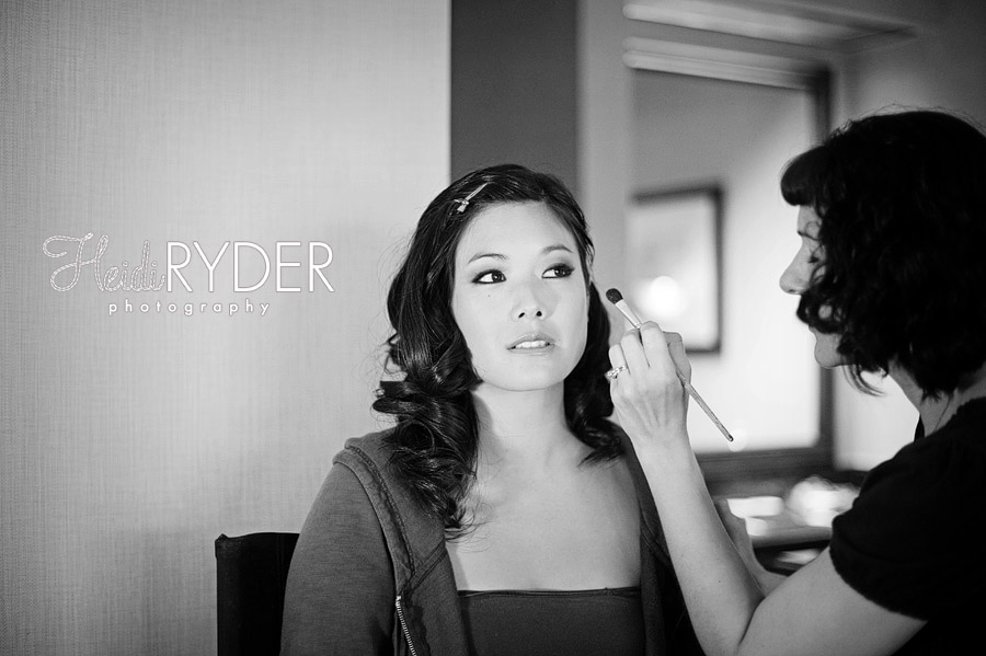 bride having makeup applied on wedding day