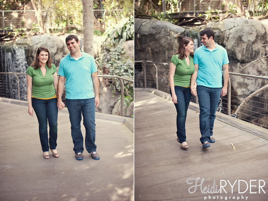 couple walking through bird aviary at zoo