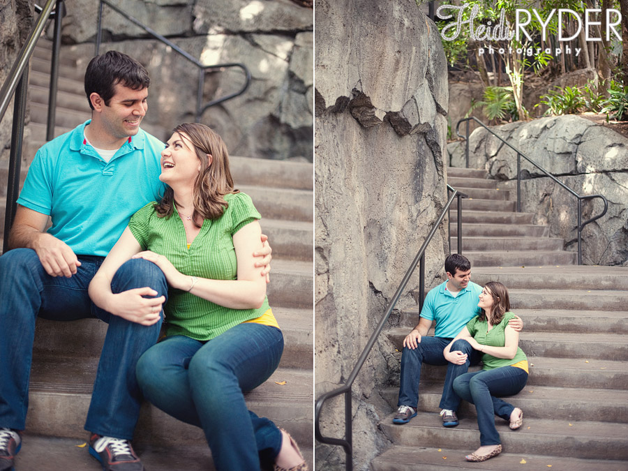 couple sitting on steps at zoo