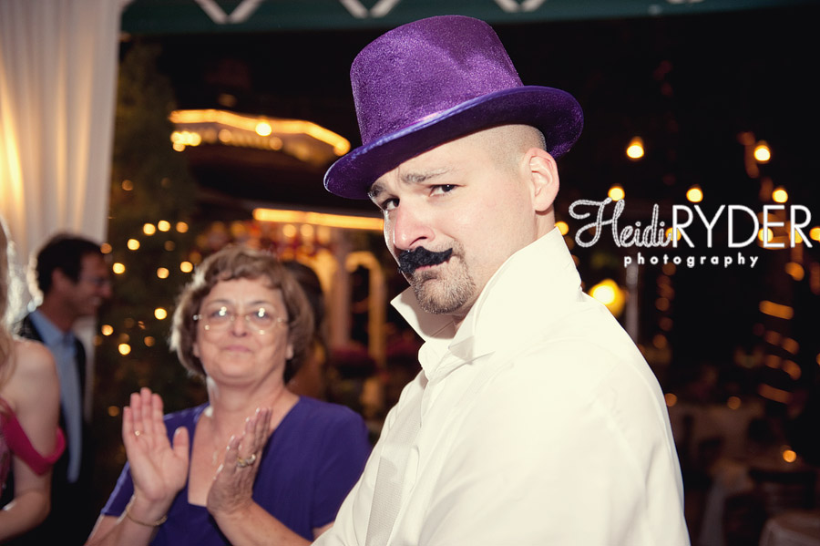 groom in hat and fake moustache