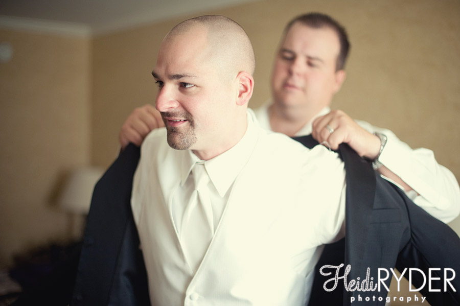 groom getting dressed on wedding day