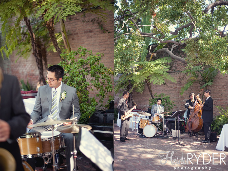groom playing drums at wedding reception