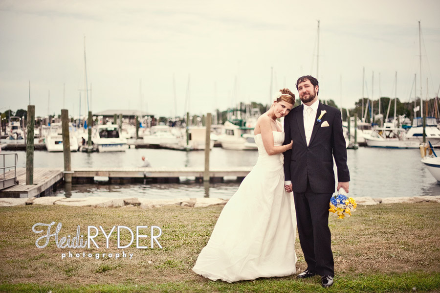 bride and groom in front of yachts