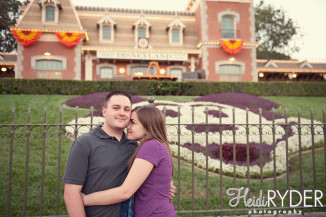 engaged couple with mickey mouse