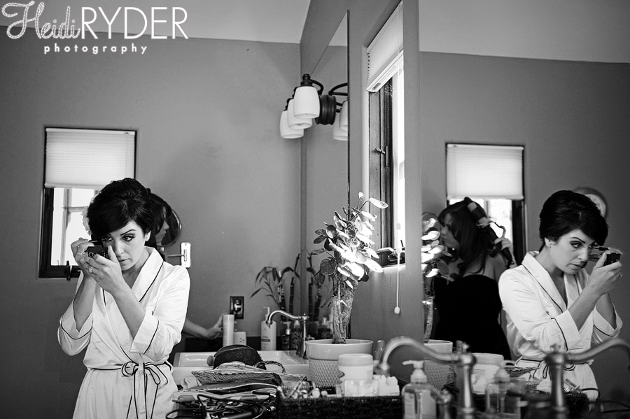 bride putting on makeup