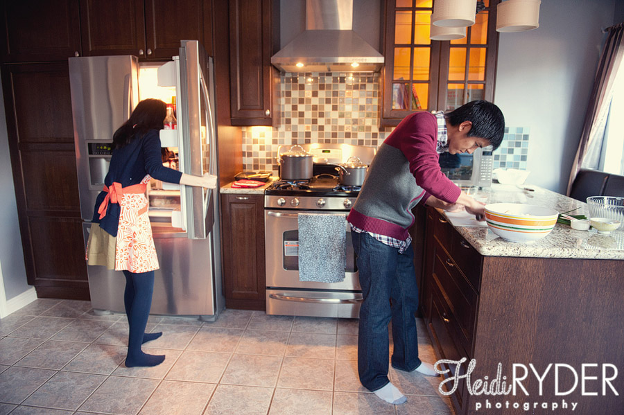 engaged couple cooking together